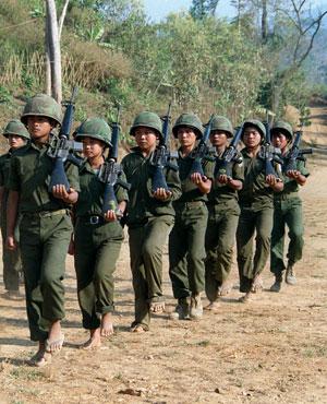 Child Karen soldiers march near Myanmar's border with Thailand (credit: AFP).