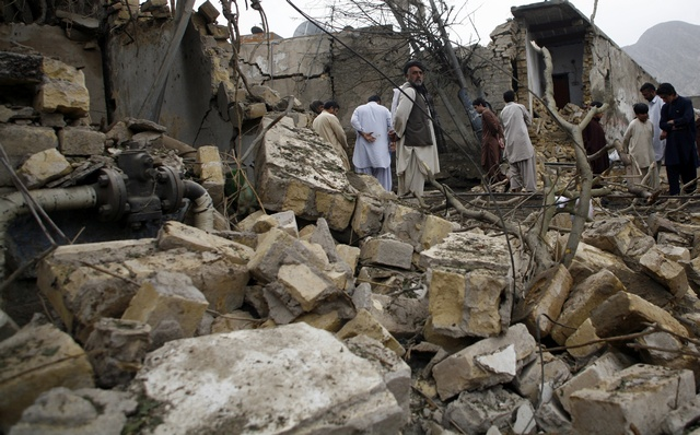 Onlookers at the site of one of a series of Taliban attacks against civilians in the spring of 2013 on the eve of the country's parliamentary elections. (Credit: Human Rights Watch).