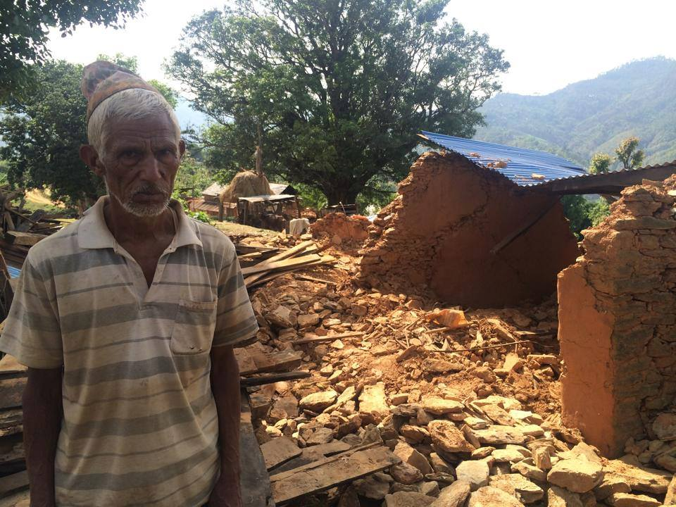 In the village of Dhawa an image captures the material destruction and human suffering of the recent earthquake (Credit: Learning Planet, https://www.facebook.com/LearningPlanet).