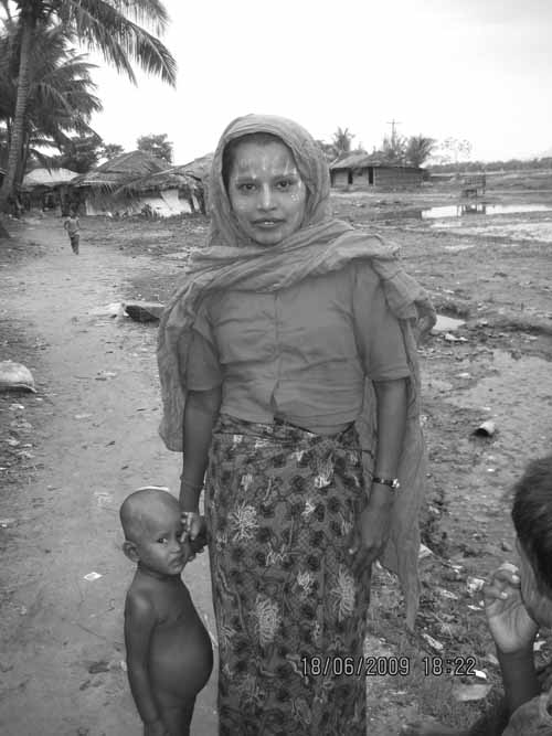 A Rohingya woman and her child standing near the fishing village (Jalia Para) in Teknaf, a home for many undocumented refugees. The area gets flooded everyday by the tidal wave from the River Naff (Credit: Kazi Fahmida Farzana).